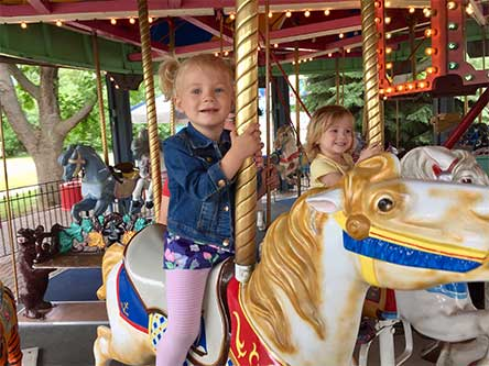 Girl riding carousel